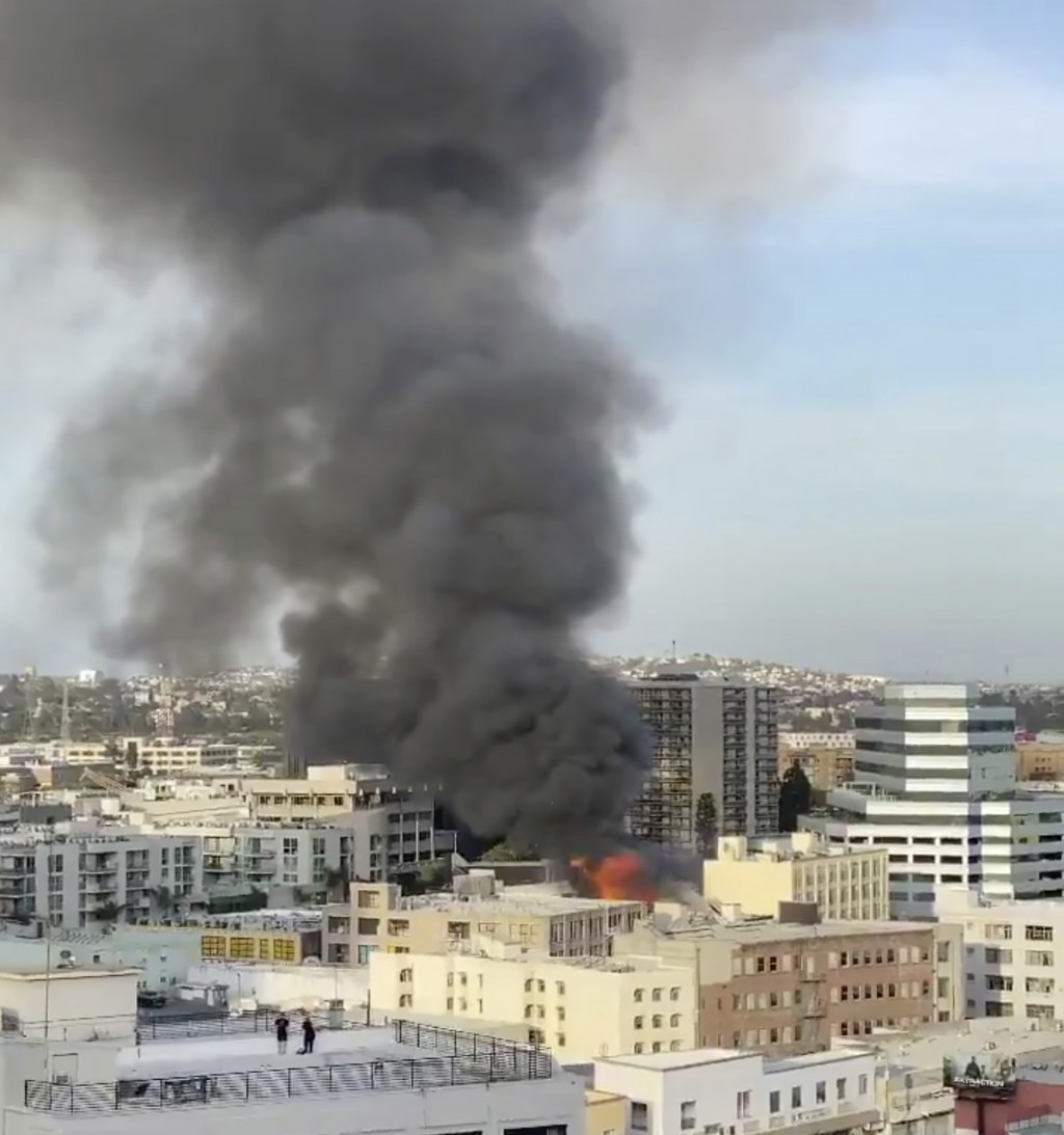 In this screen grab from video provided by Celia Esguerra of @RawMaterials, fire from an explosion is seen Saturday, May 16, 2020, in Los Angeles. (Ce...