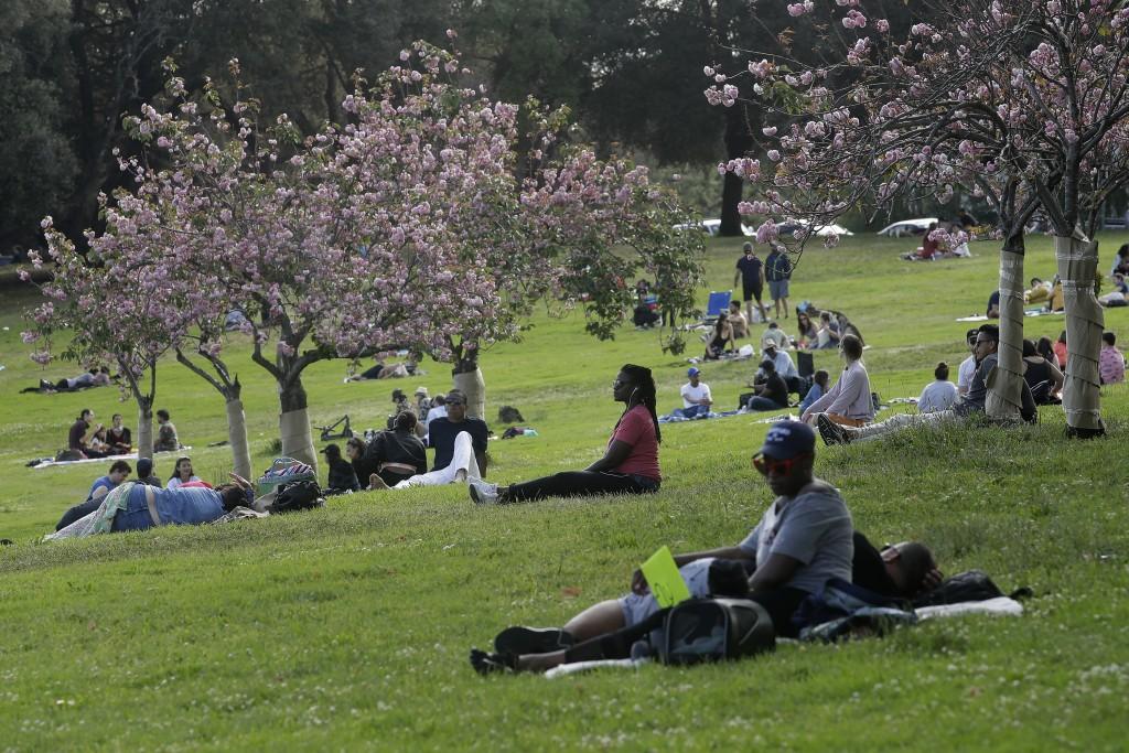 People visit Lake Merritt during the coronavirus outbreak in Oakland, Calif., Saturday, May 16, 2020. (AP Photo/Jeff Chiu)