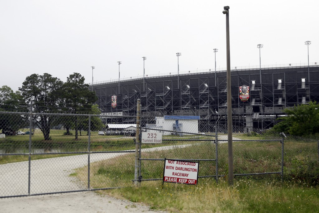 A gate is locked outside Darlington Raceway Sunday, May 17, 2020, in Darlington, S.C. NASCAR, which has been idle since March 8 because of the coronav...