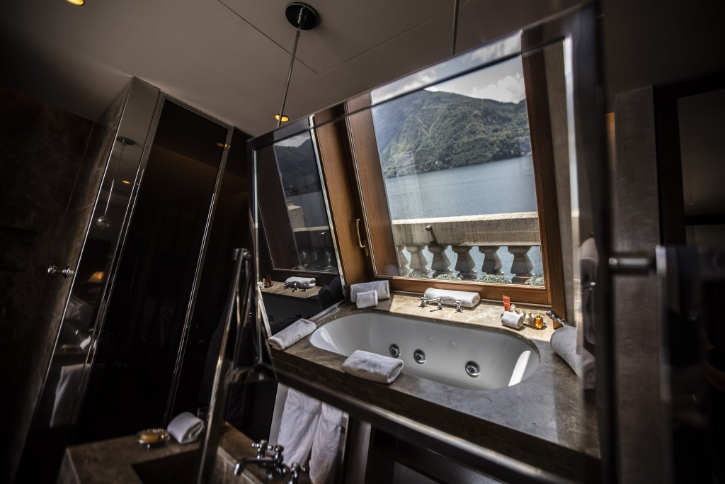 This picture taken on Thursday, May 14, 2020, shows a bathtub overlooking the lake, reflected on a bathroom mirror of the historical Grand Hotel Treme...