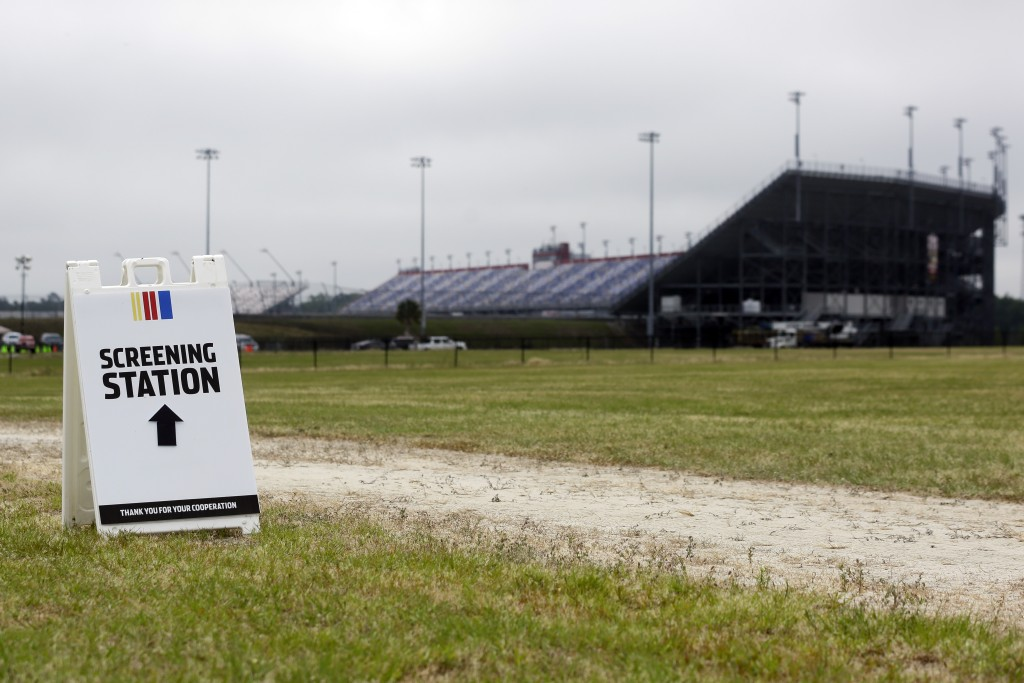 A sign directs people to a screening station outside Darlington Raceway Sunday, May 17, 2020, in Darlington, S.C. NASCAR, which has been idle since Ma...