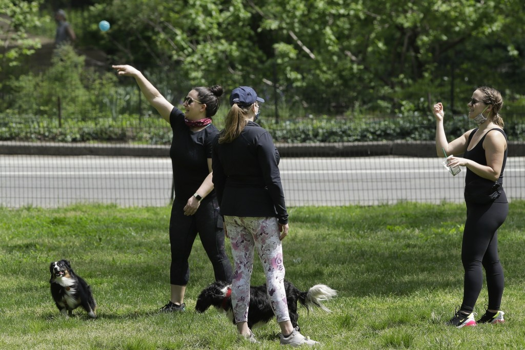 People enjoy warm weather during the coronavirus pandemic in Central Park Saturday, May 16, 2020, in New York. (AP Photo/Frank Franklin II)