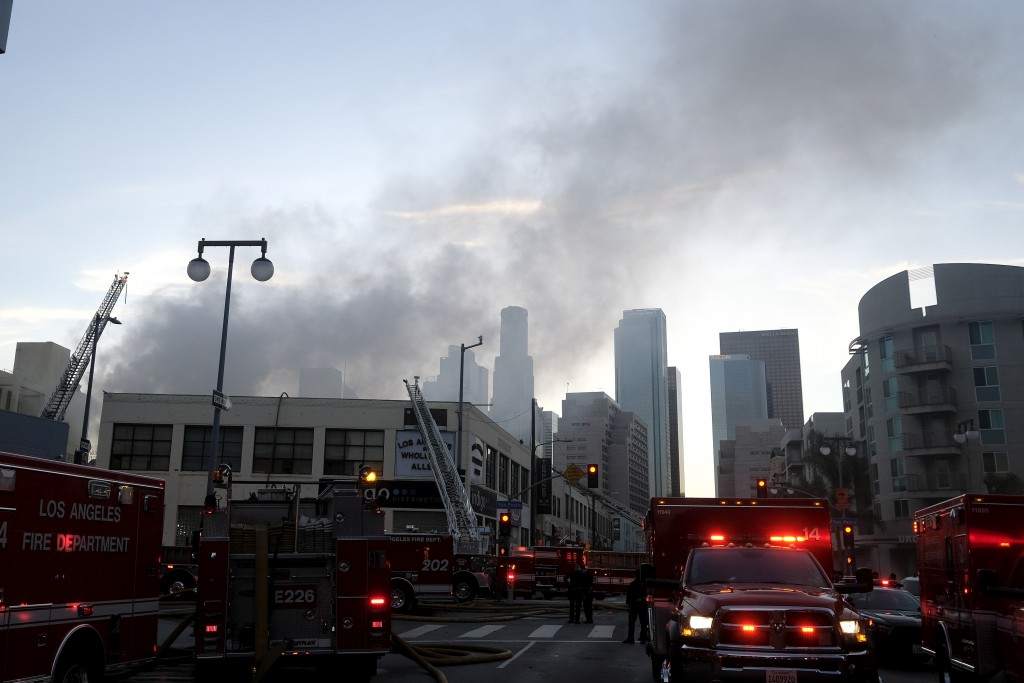 Smoke rises from the scene of a structure fire that injured multiple firefighters, according to a fire department spokesman, Saturday, May 16, 2020, i...