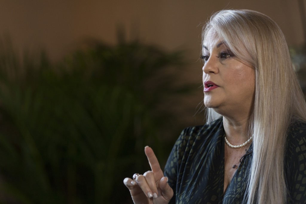 FILE - In this Aug. 16, 2019 file photo, Puerto Rico Gov. Wanda Vazquez speaks during an interview with the Associated Press at the official residence...