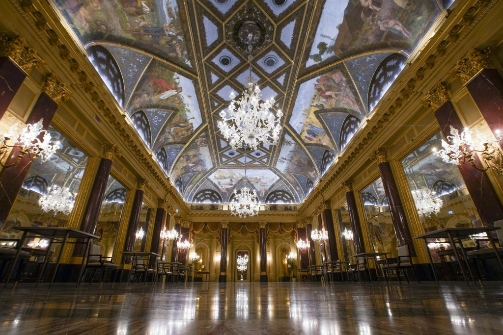 This picture taken Wednesday, May 13, 2020 shows the frescoed ceilings of the Ritz Ballroom of the St. Regis Rome hotel, built in 1894, in Rome. (AP P...
