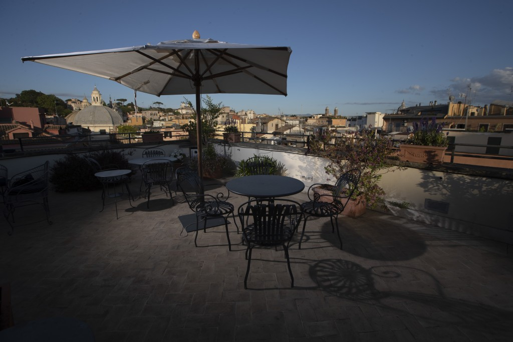 This Monday, May 11, 2020 photo shows the empty rooftop terrace of the art-deco style Locarno Hotel, in Rome, Monday, May 11, 2020. (AP Photo/Alessand...