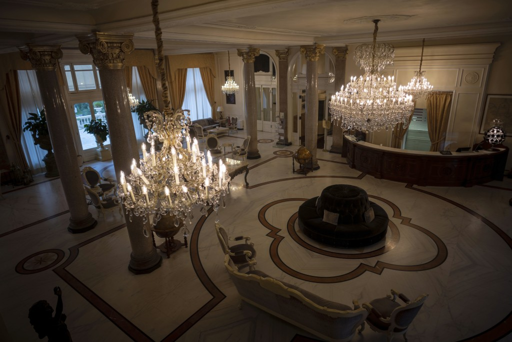This Monday, May 11, 2020 photo shows an empty foyer of the Rimini Grand Hotel, in Rimini, Italy. The luxury Liberty-style hotel, where carnivalesque ...