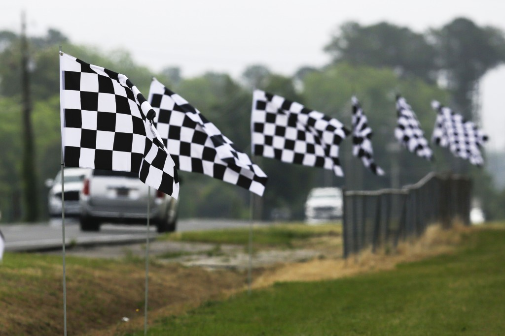 Checkered flags line a street outside Darlington Raceway Sunday, May 17, 2020, in Darlington, S.C. NASCAR, which has been idle since March 8 because o...
