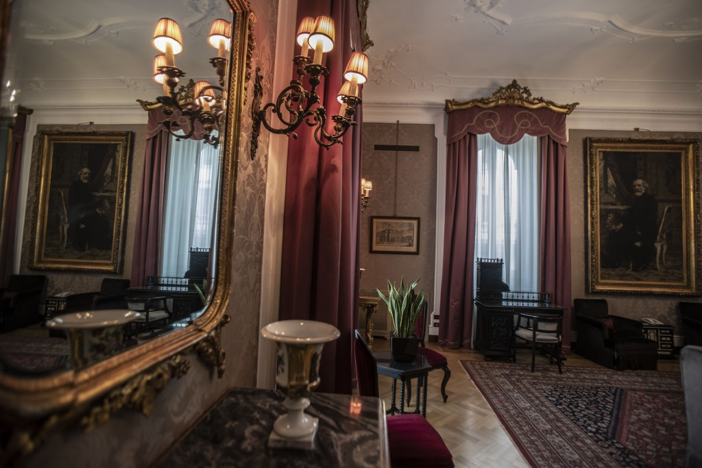This Thursday, May 14, 2020 picture shows the Giuseppe Verdi suite where 19th century composer Giuseppe Verdi, pictured on the painting, stayed, in Mi...