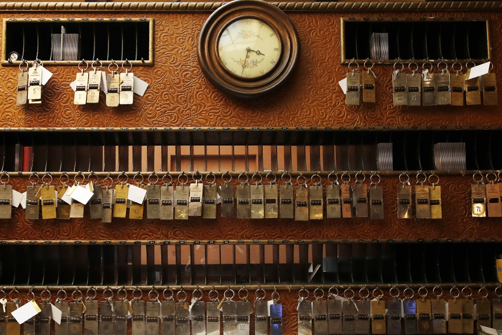 In this picture taken on Wednesday, May 13, 2020 keys hang at the reception of the Saturnia hotel, founded in 1908, in Venice, Italy. The hotel is cur...