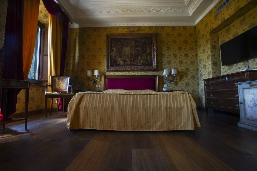 This Monday, May 11, 2020 photo shows a bedroom of the Atlante Star Hotel, in Rome. The hotel remained open during the lockdown measures due to COVID-...