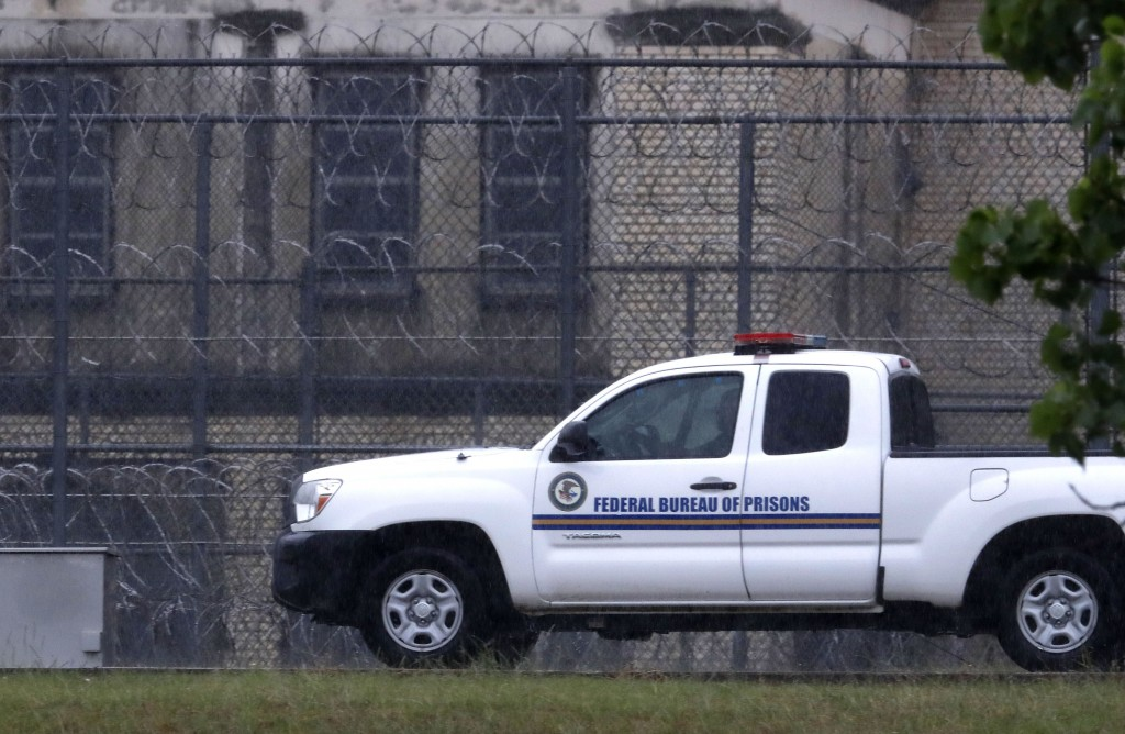 A Federal Bureau of Federal Prisons truck drives past barbed wire fences at the Federal Medical Center prison in Fort Worth, Texas, Saturday, May 16, ...