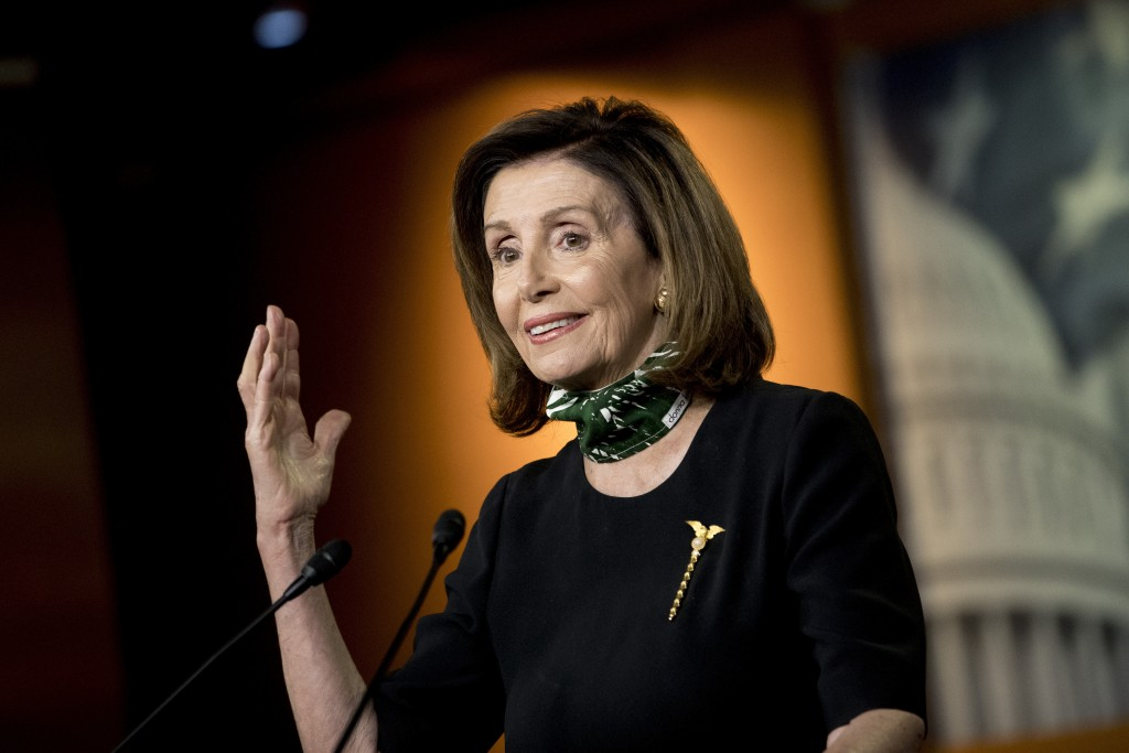 FILE - In this May 14, 2020, file photo House Speaker Nancy Pelosi of Calif., speaks during a news conference on Capitol Hill in Washington. Four of t...
