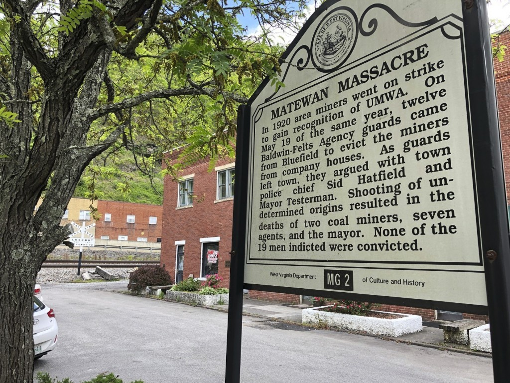In this Tuesday, May 12, 2020, photo a historical sign stands outside a former post office in Matewan, W.Va. On May 19, 1920, a group of miners, who w...