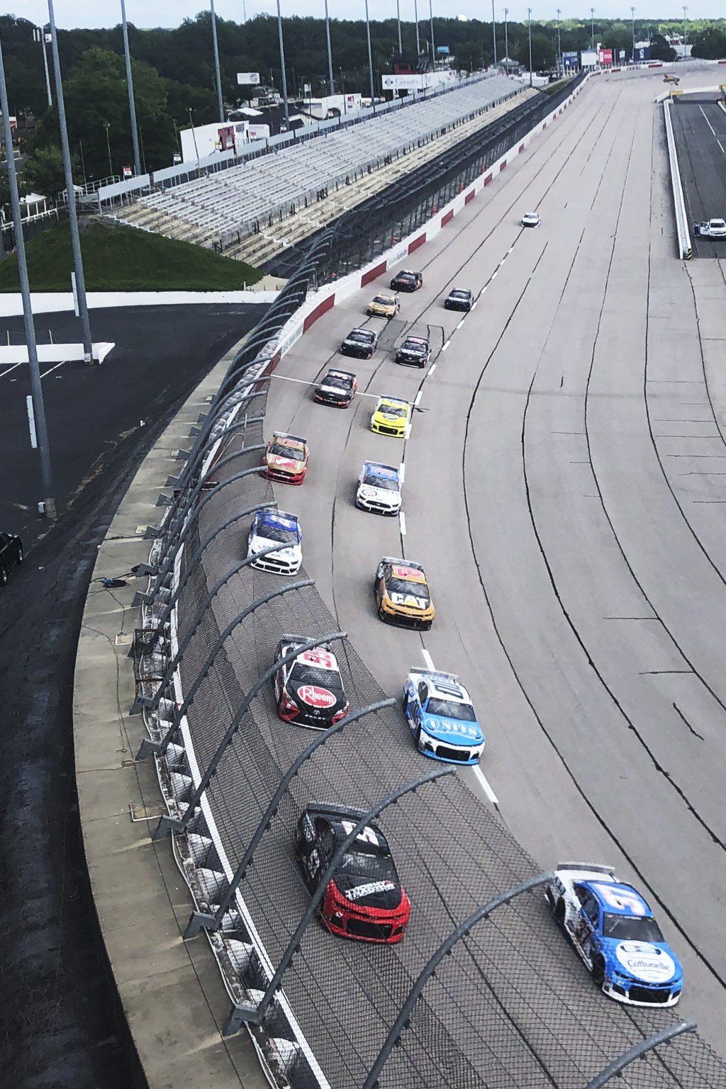 Drives head through a turn in front of an empty grandstand during the NASCAR Cup Series auto race Sunday, May 17, 2020, in Darlington, S.C. (AP Photo/...
