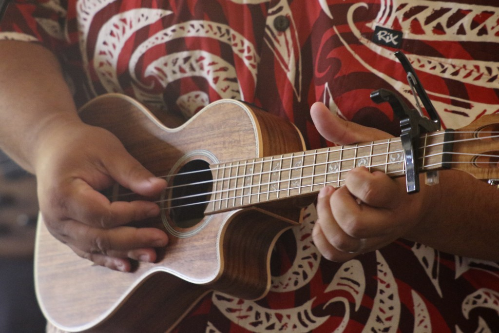This May 5, 2020, photo shows Lance Chang playing a ukulele during a livestream performance of his family's band, Kanilau, from the living room of his...