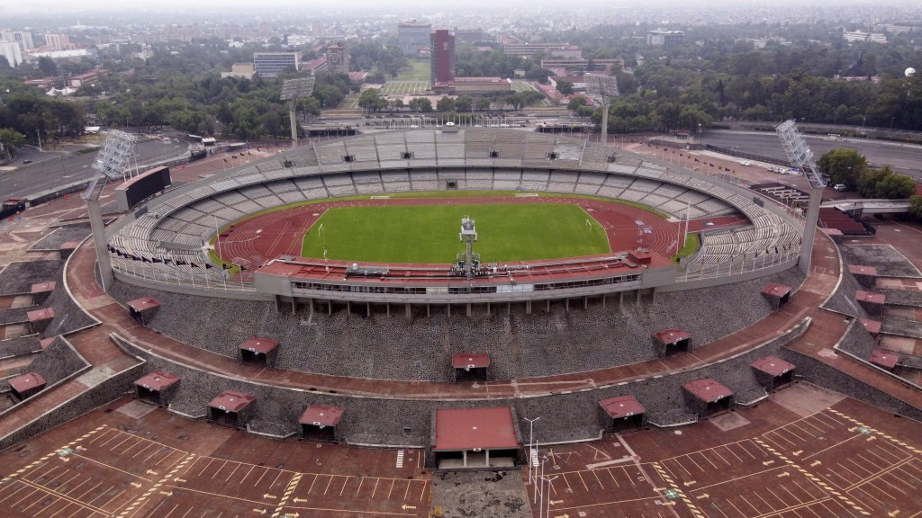 The Olympic Stadium stands empty as Mexico City faces its lockdown to help slow the spread of the new coronavirus, Sunday, May 17, 2020. (AP Photo/Chr...