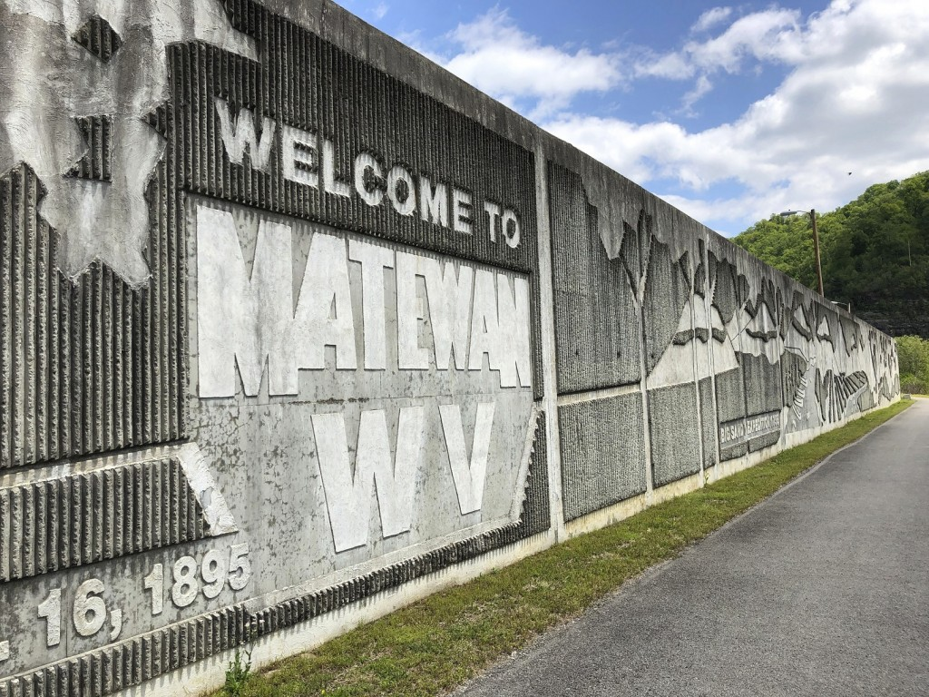 In this Tuesday, May 12, 2020, photo is a floodwall protecting the town of Matewan, W.Va, from the Tug Fork of the Big Sandy River. (AP Photo/John Rab...