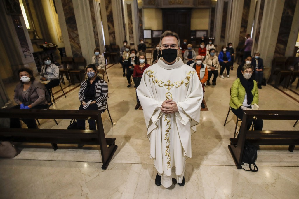 Parson Don Giuseppe Corbari poses prior to the start of a mass with faithfuls the SS. Quirico and Giulitta Church in Robbiano di Giussano, northern It...