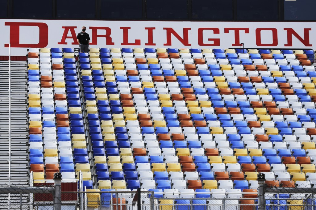 A man stands in an otherwise empty grandstand at Darlington Raceway before the Real Heroes 400 NASCAR Cup Series auto race Sunday, May 17, 2020, in Da...