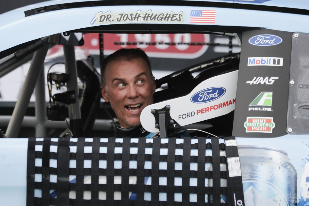 Kevin Harvick arrives in victory lane after winning the NASCAR Cup Series auto race Sunday, May 17, 2020, in Darlington, S.C. (AP Photo/Brynn Anderson...