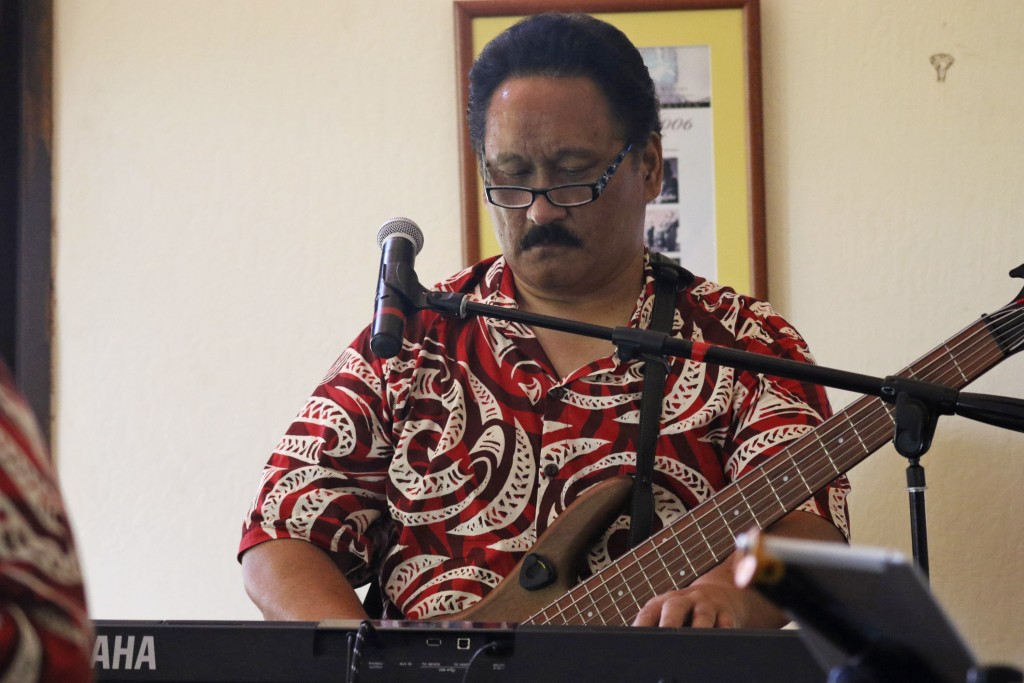 This May 5, 2020 photo shows Roland Chang playing keyboard during a livestream performance of his family's band, Kanilau, from the living room of his ...