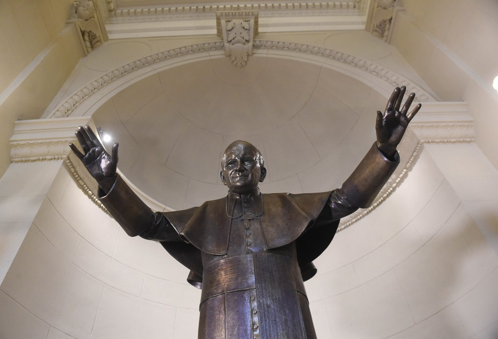 The new statue of Pope John Paul II is seen at the St. Stephen Basilica in Budapest, Hungary, Monday, May 18, 2020, as the as part of celebrations the...