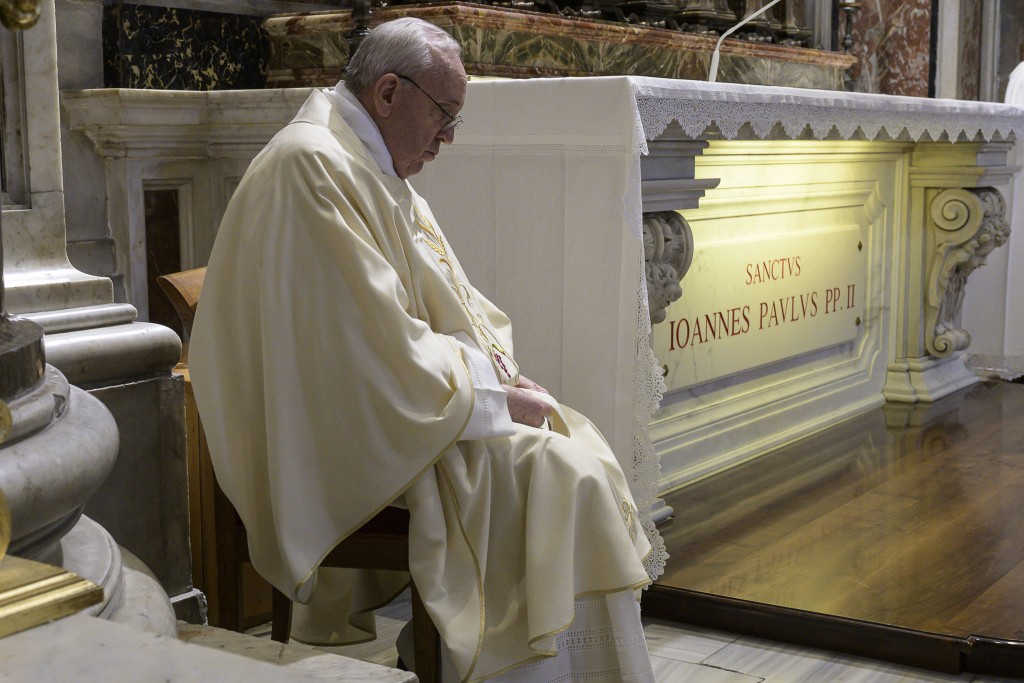 Pope Francis meditates as he celebrates a Mass for the 100th anniversary of the birth of Pope John Paul II, in St. Peter's Basilica, at the Vatican Mo...