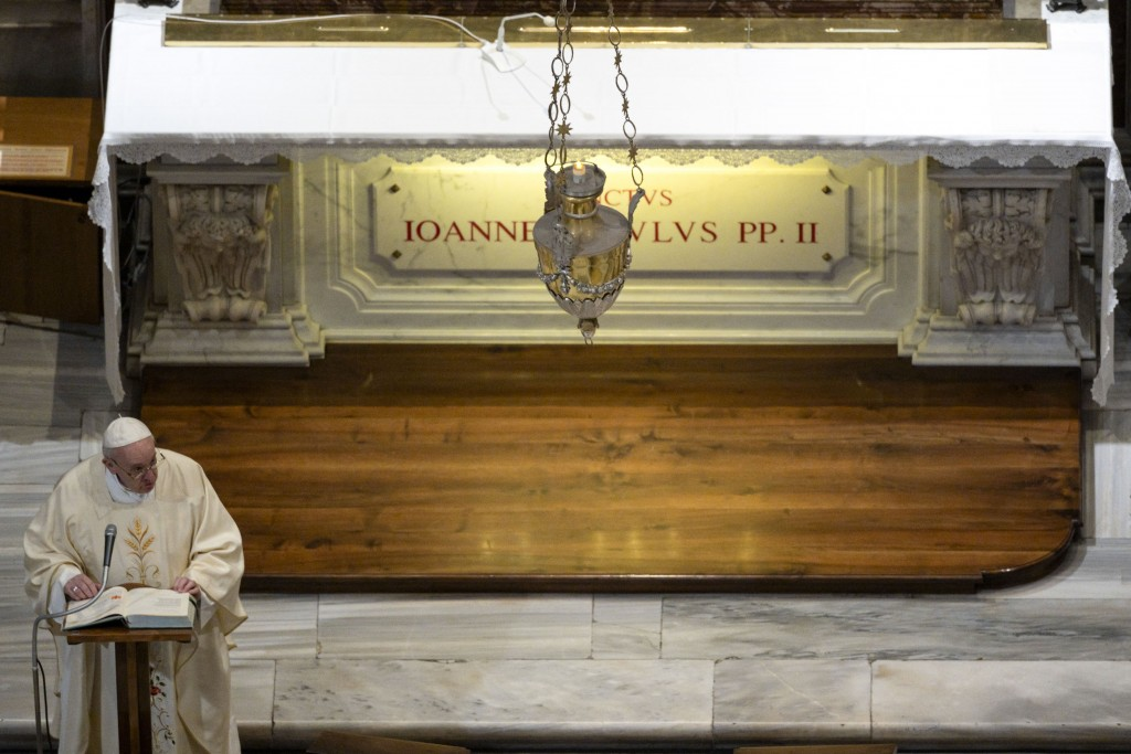 Pope Francis celebrates a Mass for the 100th anniversary of the birth of Pope John Paul II, in St. Peter's Basilica, at the Vatican Monday, May 18, 20...