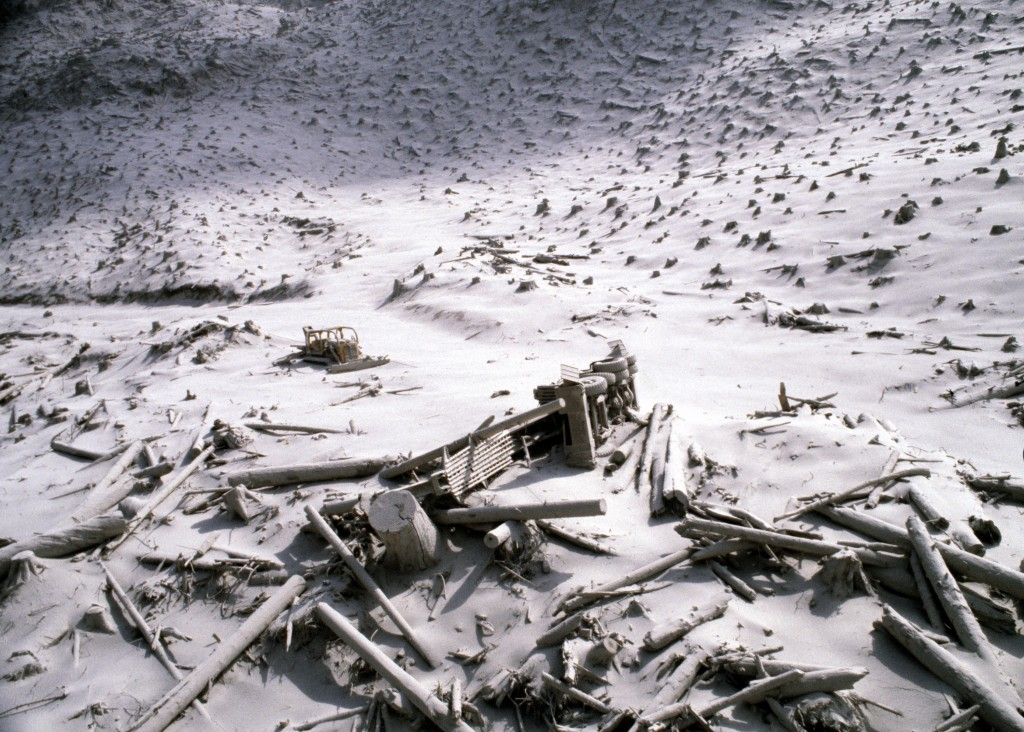 FILE - In this May 20, 1980, file photo, a wrecked logging truck and crawler tractor are shown amidst ash and downed trees near Mount St. Helens two d...