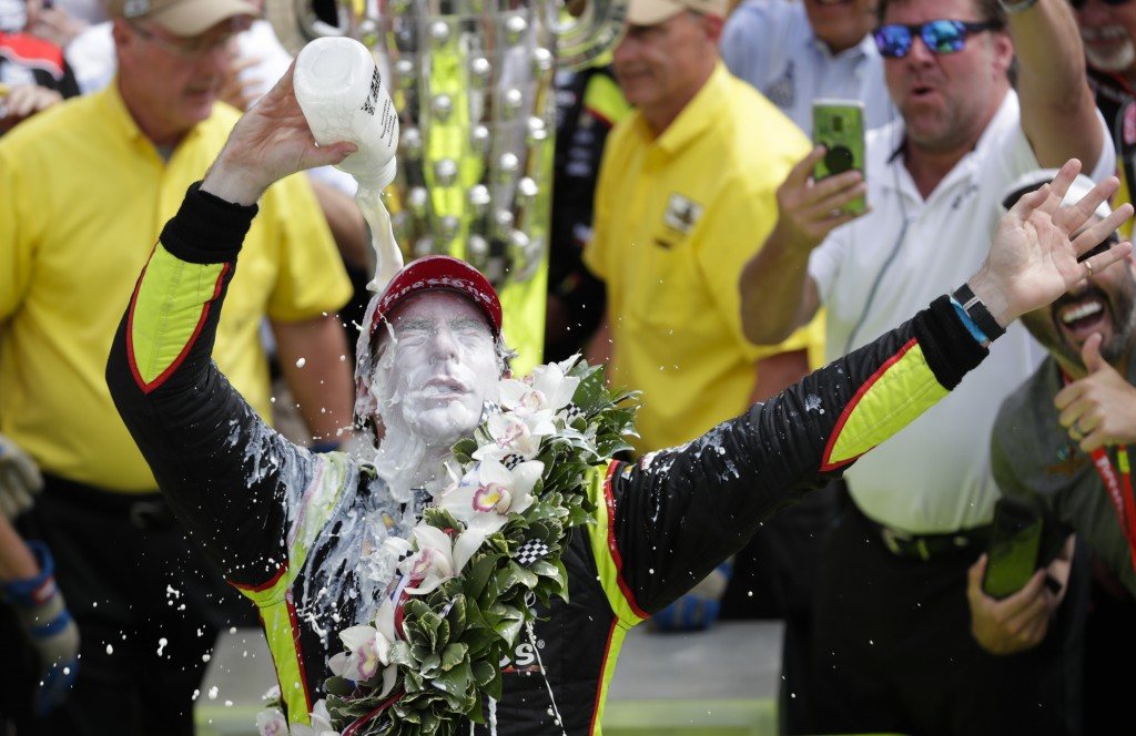 FILE - This May 26, 2019, file photo shows Simon Pagenaud, of France, celebrating after winning the Indianapolis 500 IndyCar auto race at Indianapolis...