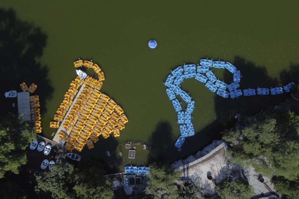 Paddleboats float moored and unused on Chapultepec lagoon as Mexico City faces its lockdown to help slow the spread of the new coronavirus, Sunday, Ma...