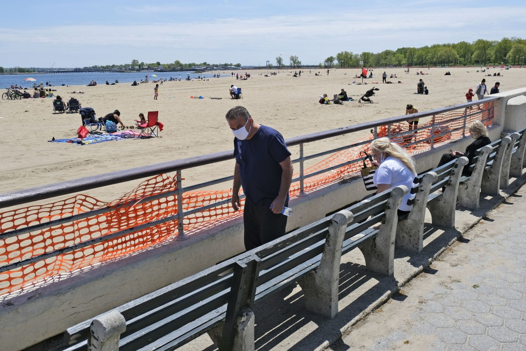 People get some fresh air at Orchard Beach in the Bronx borough of New York, Sunday, May 17, 2020. Parks, boardwalks and beaches attracted some crowds...