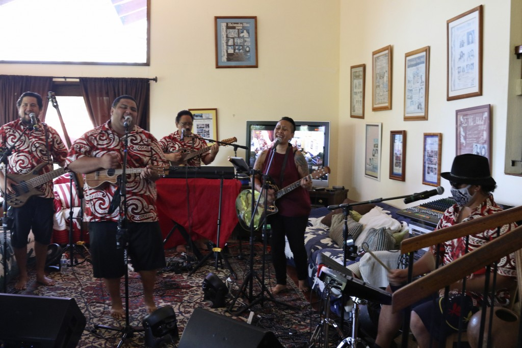 In this May 5, 2020, photo Kanilau, the Chang family's band, plays music for a livestream performance from the living room of Roland Chang's home in H...
