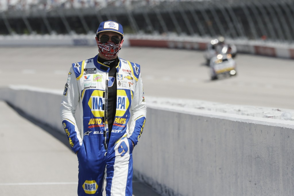Driver Chase Elliott walks to his car for the start of the NASCAR Cup Series auto race Sunday, May 17, 2020, in Darlington, S.C. (AP Photo/Brynn Ander...