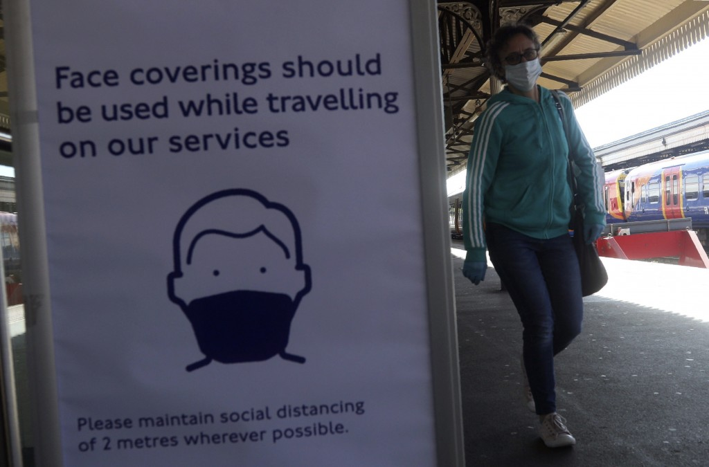 A sign advising passengers to wear a face mask at Clapham Junction station as train services increased as part of the easing of coronavirus lockdown r...