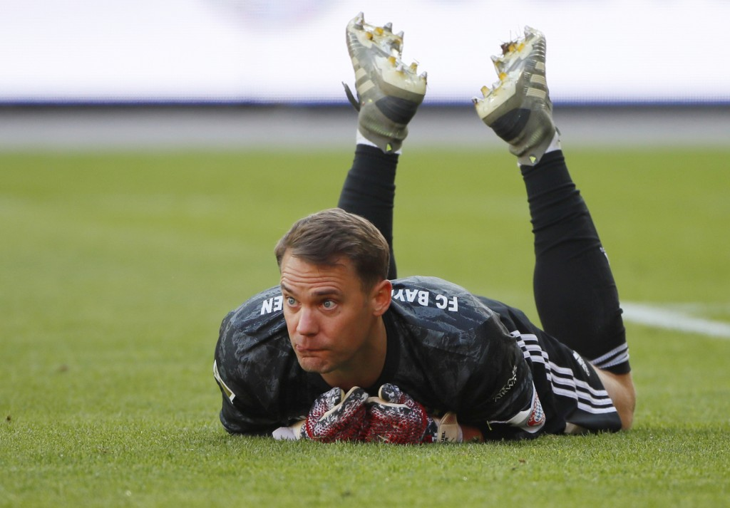 Goal keeper Manuel Neuer of Munich lies on the pitch during the German Bundesliga soccer match between Union Berlin and Bayern Munich in Berlin, Germa...