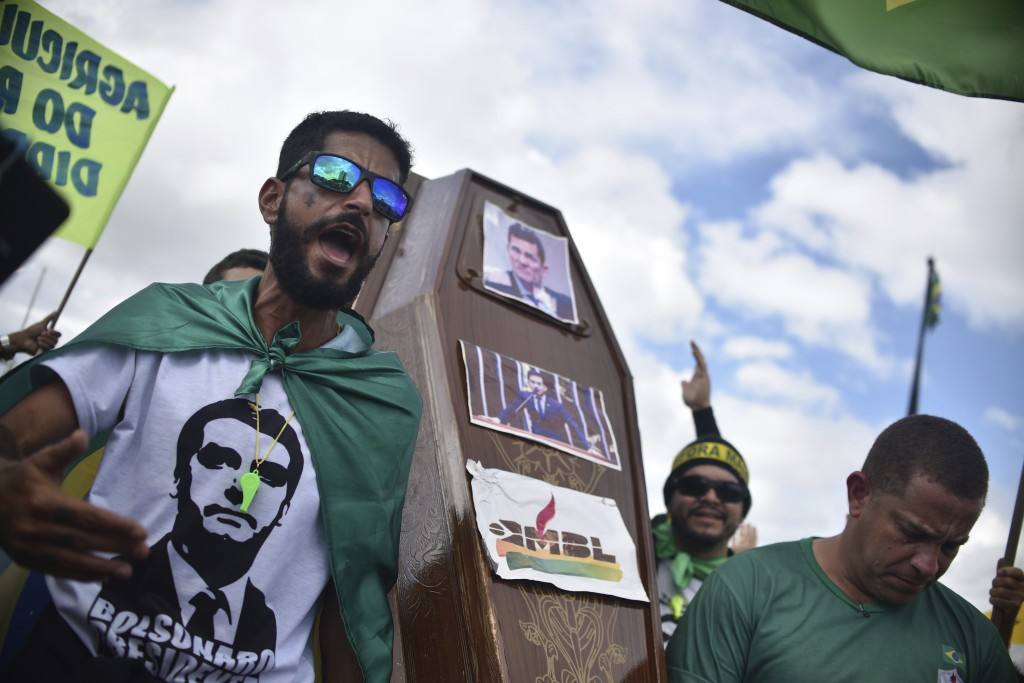 Supporters of Brazil's President Jair Bolsonaro carry a coffin with the image of former Justice Minister Sergio Moro during a protest against the Supr...
