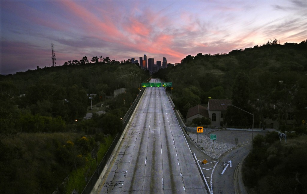 FILE - In this April 26, 2020, file photo, empty lanes of the 110 Arroyo Seco Parkway that leads to downtown Los Angeles is seen during the coronaviru...