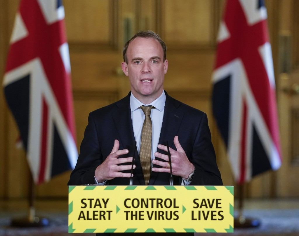 In this handout photo provided by 10 Downing Street, Britain's Foreign Secretary Dominic Raab speaks during a media briefing on coronavirus (COVID-19)...