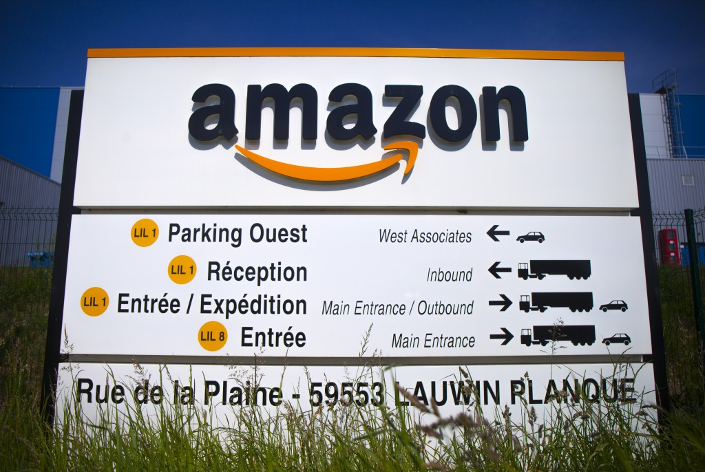 FILE - In this April 16, 2020 file photo, the Amazon logo is seen in Amazon, in Lauwin Planque, northern France. Amazon is gradually reopening its war...
