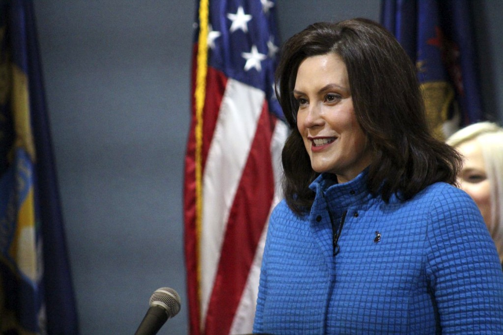 In this Monday, May 18, 2020 photo provided by the Michigan Office of the Governor, Michigan Gov. Gretchen Whitmer seeks during a news conference in L...