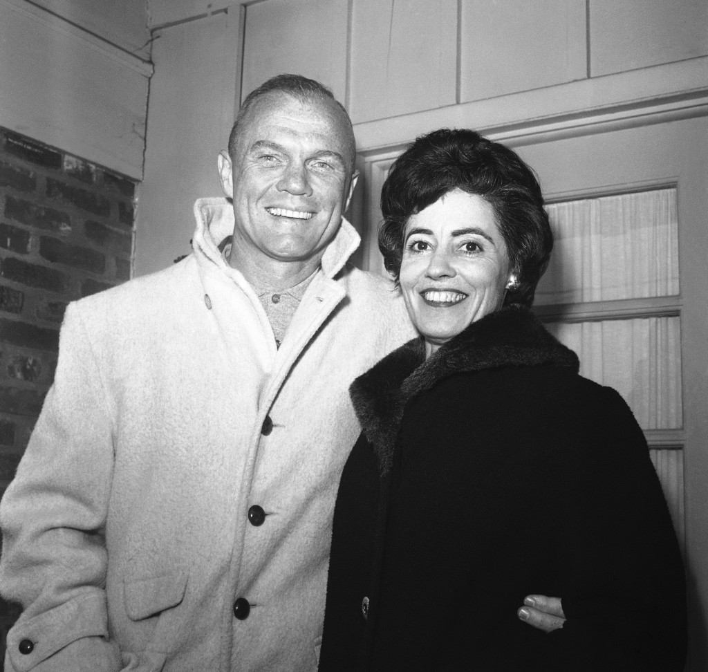 In this Feb. 3, 1962 file photo, astronaut John Glenn poses with his wife, Annie,  outside their Arlington, Va., home during his first news conference...