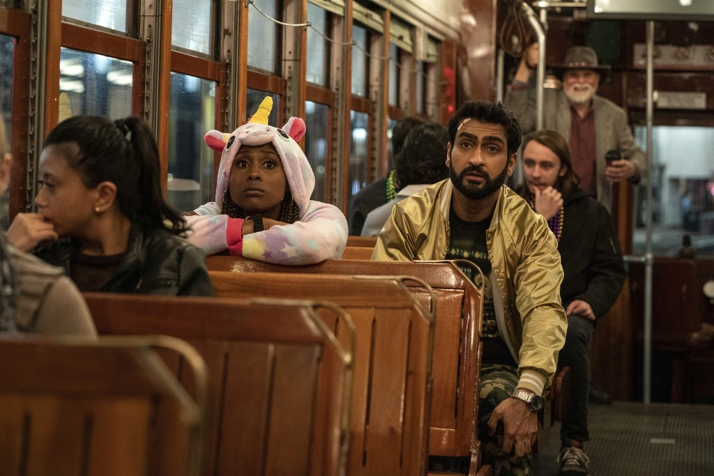 "This image released by Netflix shows Issa Rae as Leilani, left, and Kumail Nanjiana as Jibran in a scene from ""The Lovebirds."" (Skip Bolen/Netflix via..."