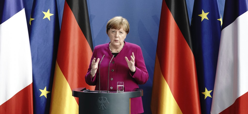 German Chancellor Angela Merkel speaks during a press conference following a joint video conference with French President Macron in Berlin, Germany, M...
