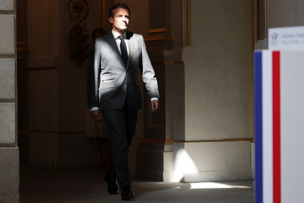 French President Emmanuel Macron arrives for a joint video press conference whith German Chancellor Angela Merkel at the Elysee Palace Monday, May 18,...