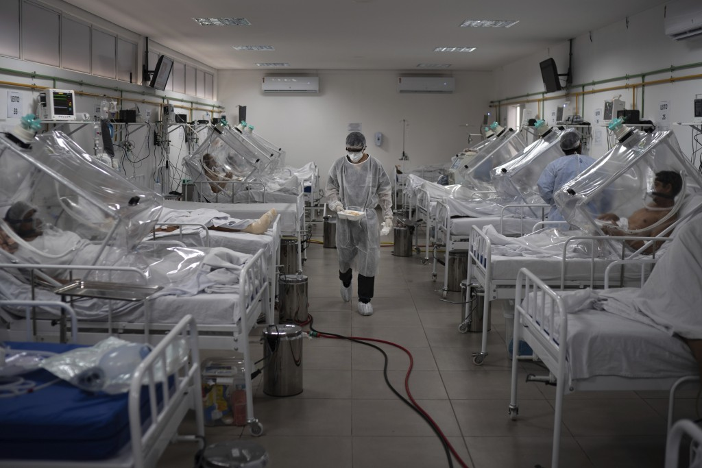 COVID-19 patients are treated inside a non-invasive ventilation system named the 'Vanessa Capsule' at the municipal field hospital Gilberto Novaes in ...