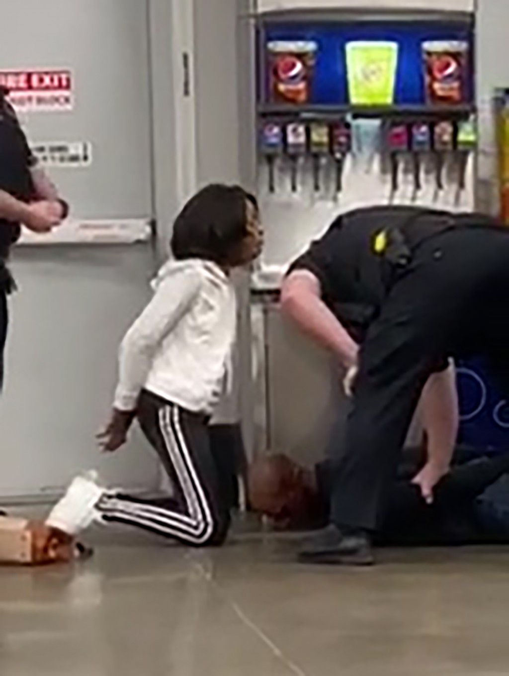 FILE - In this March 23, 2020, file frame grab taken from video, Marvia Gray, left and her son Derek Gray are arrested by white police officers at a S...