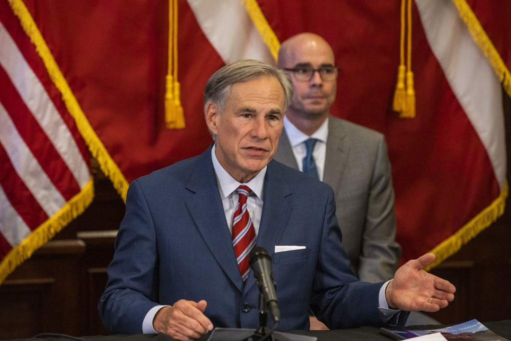 Texas Gov. Greg Abbott announces the reopening of more Texas businesses during the COVID-19 pandemic at a press conference at the Texas State Capitol ...