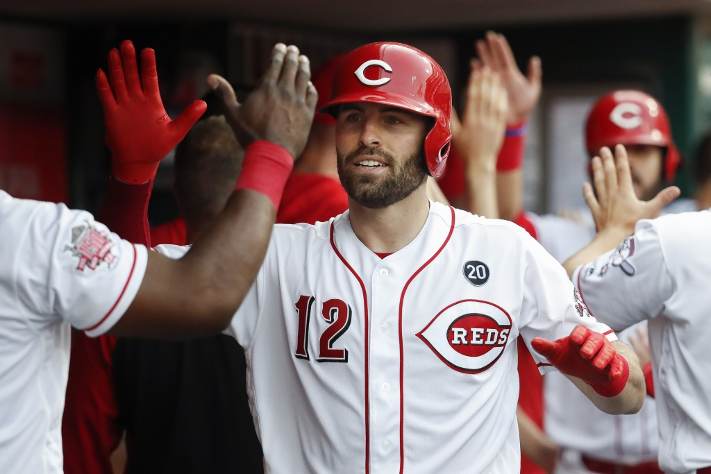 FILE - In this May 31, 2019, file photo, Cincinnati Reds' Curt Casali celebrates in the dugout after hitting a three-run home run off Washington Natio...
